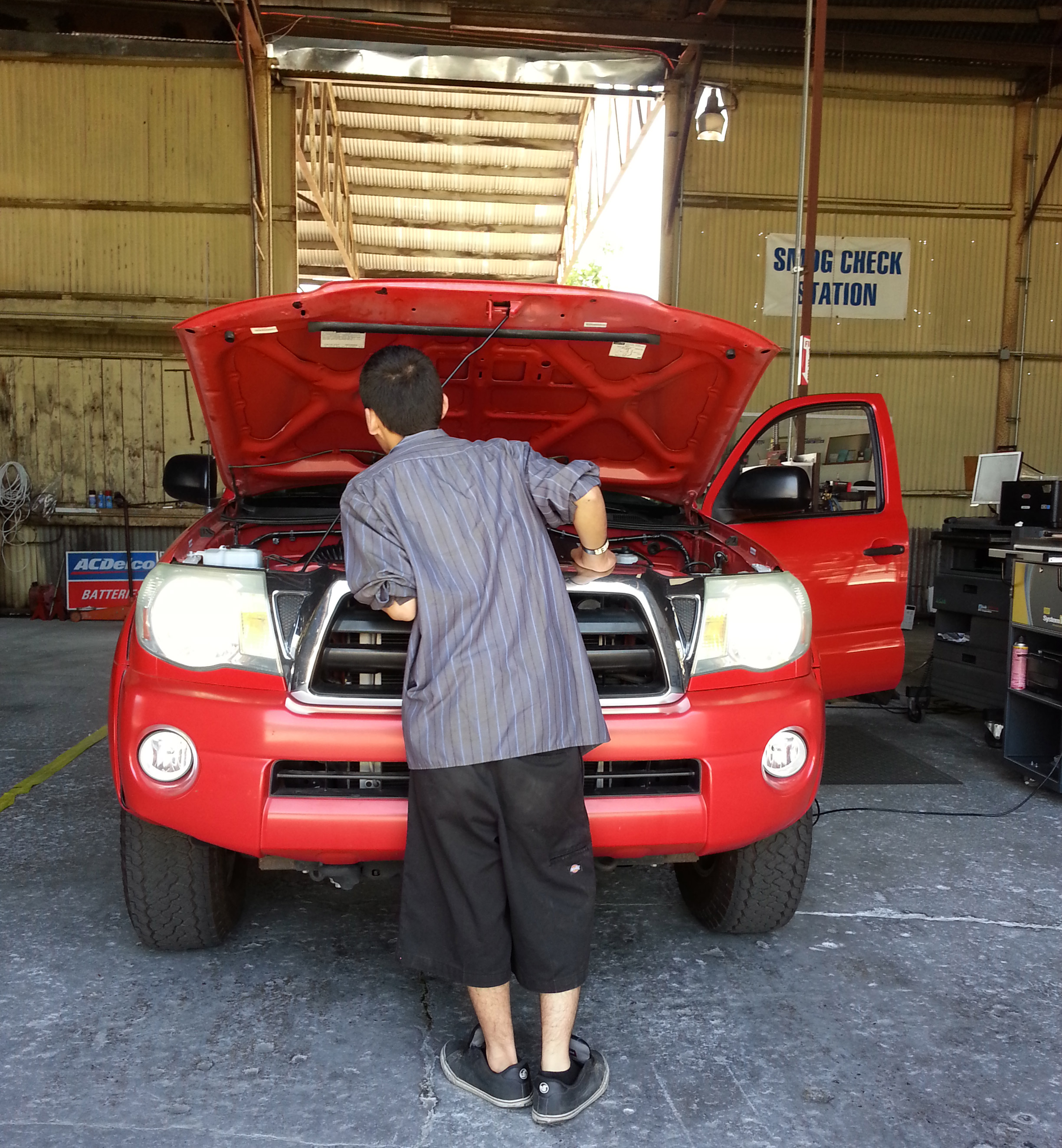 Red Car Serviced by proffesional mechanic